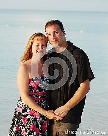 Happy couple by sea