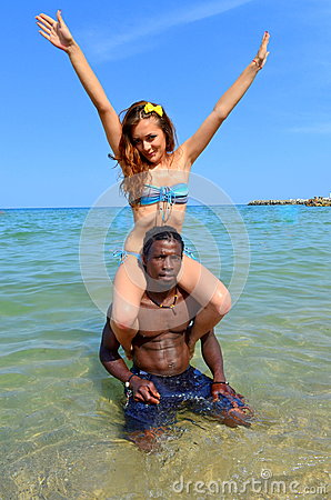 Happy couple at the seaside-human tower