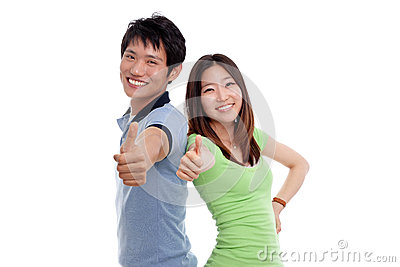 Happy couple showing thumbs.