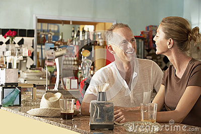 Happy Couple Sitting In Bar