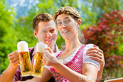 Happy Couple in Beer garden drinking beer