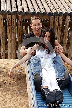 Happy couple sliding