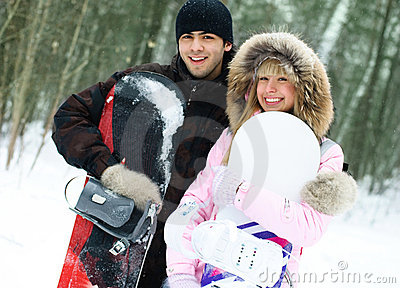 Happy couple with snowboards