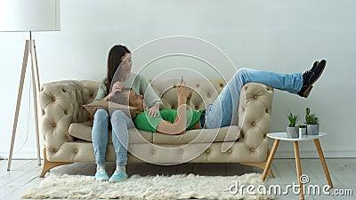 Happy couple on sofa enjoying leisure at home stock video