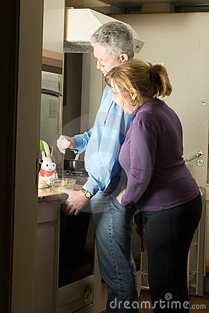 Happy Couple Spending Time Cooking - Vertical