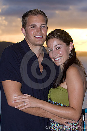 Happy couple with sunset