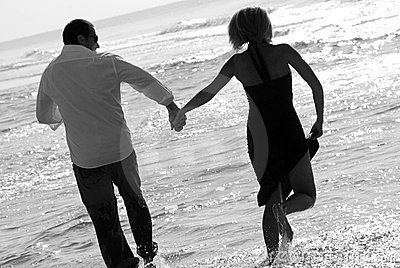 Happy couple in surf