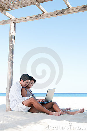 Happy couple surfing the net outdoor