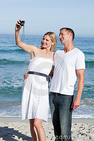 Happy couple taking pictures of themselves