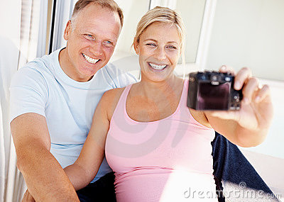 Happy couple - Taking a self portrait with camera