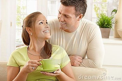 Happy couple with tea cup