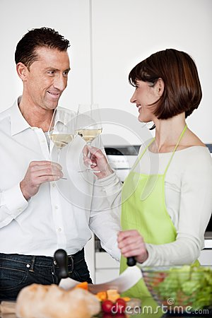 Happy Couple Toasting With Glass Of Wine