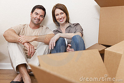 Happy Couple Unpacking Packing Boxes Moving House