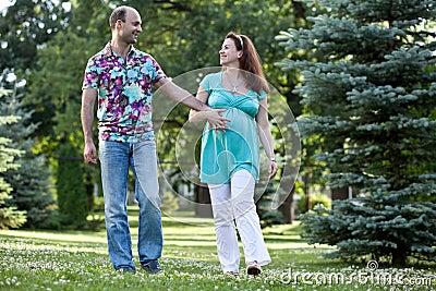 Happy couple walk in park
