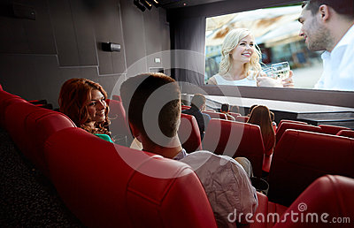 Products For Going out with In Spain happy couple watching movie talking theater cinema entertainment communication people concept friends back 55131777