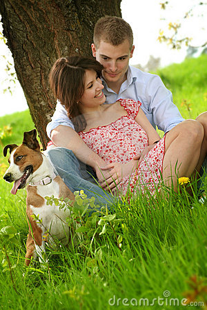 Free Happy Couple With A Dog Royalty Free Stock Photography - 5235747