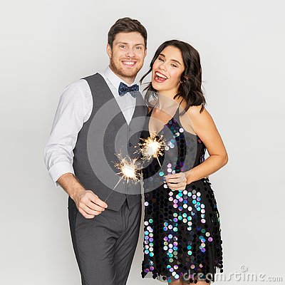 Free Happy Couple With Sparklers At Party Stock Images - 127400314