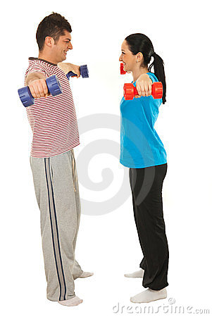 Happy couple work with dumbbells