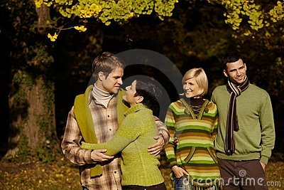 Happy couples in autumn forest