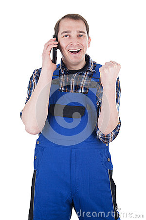 Happy craftsman on phone