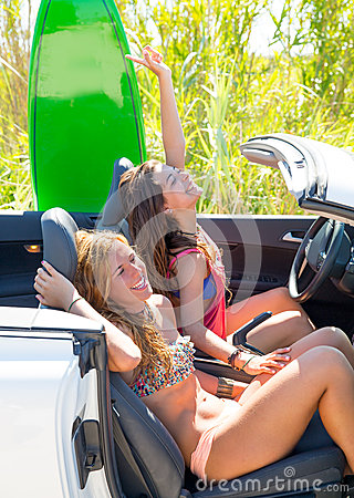 Free Happy Crazy Teen Surfer Girls Smiling On Car Stock Photos - 33328803