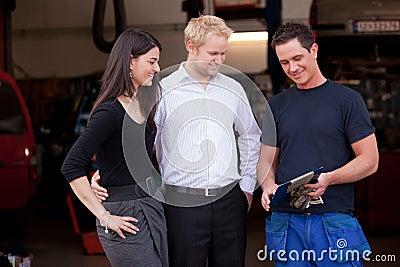 Happy Customer Couple with Mechanic