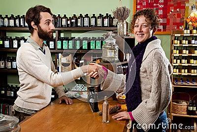 Happy customer in a herb shop