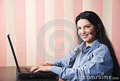 Happy customer service using laptop