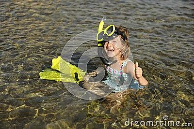 Happy cute snorkel girl on vacation