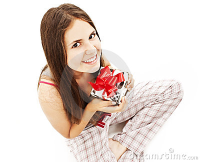 Happy cute young woman holding gift / present.