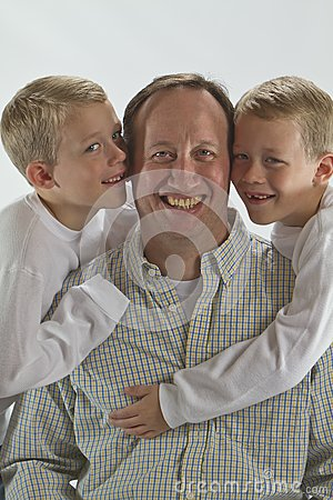 Happy dad gets a Fathers Day hug and a kiss