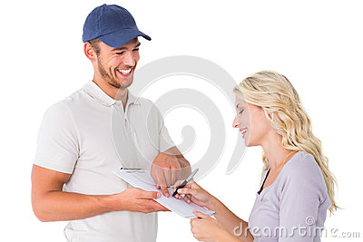 Happy delivery man getting signature from customer