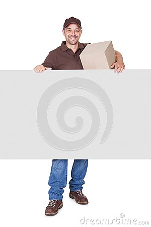 Happy Delivery Man Holding Cardbox And Placard