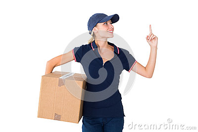 Happy delivery woman holding cardboard box and pointing up