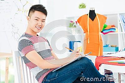 Happy dressmaker at work