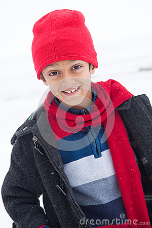 Free Happy East Indian Boy Playing In The Snow Stock Photos - 28671933