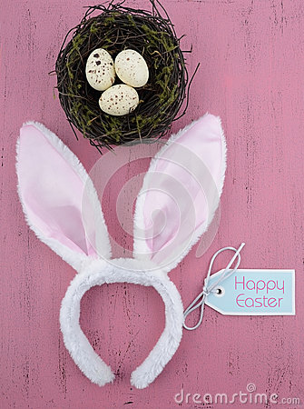 Free Happy Easter Bunny Ears With Nest On Pink Wood - Vertical. Royalty Free Stock Photography - 51091117