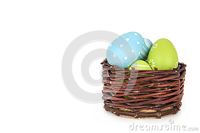 Happy Easter - few eggs on the wooden basket on the white background Stock Photo