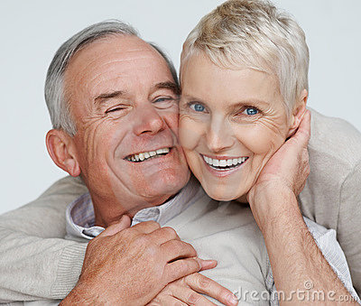 Happy elderly couple enjoying themselves