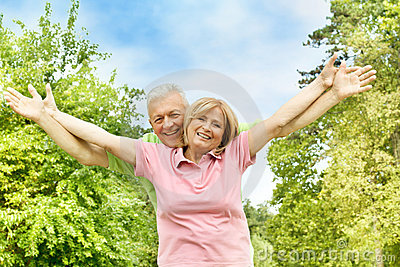 Happy elderly couple outdoors