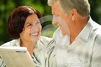 Happy elderly couple reading