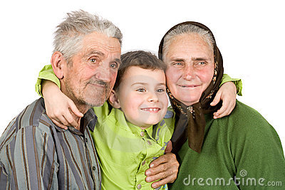 Happy elderly couple with their grandson