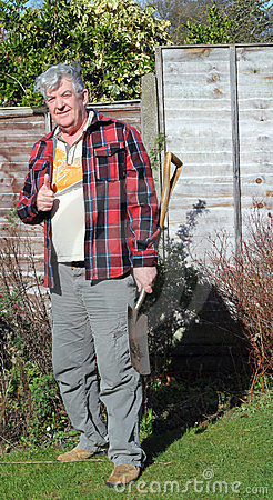 Happy elderly male gardener.