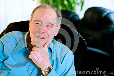 Happy Elderly man in eighties laughing