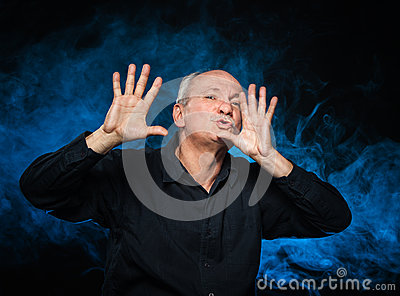 Happy elderly man gesturing