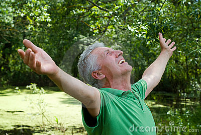 Happy elderly man in a park