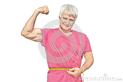 Happy elderly man in red shirt with measuring tape. Elderly man shows own biceps of arm isolated on white background Stock Photo