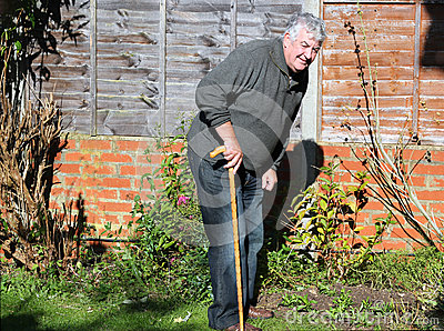 Happy elderly man with walking stick.