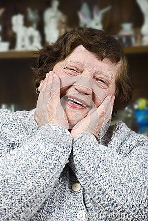 Happy elderly woman face