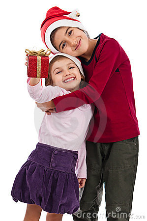 Happy embraced children with present at Christmas